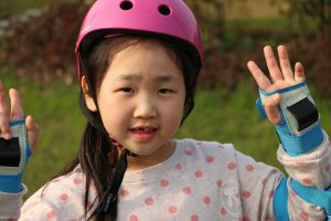girl in helmet and wristguards