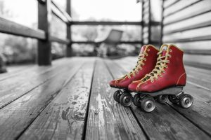 Old roller skates on porch